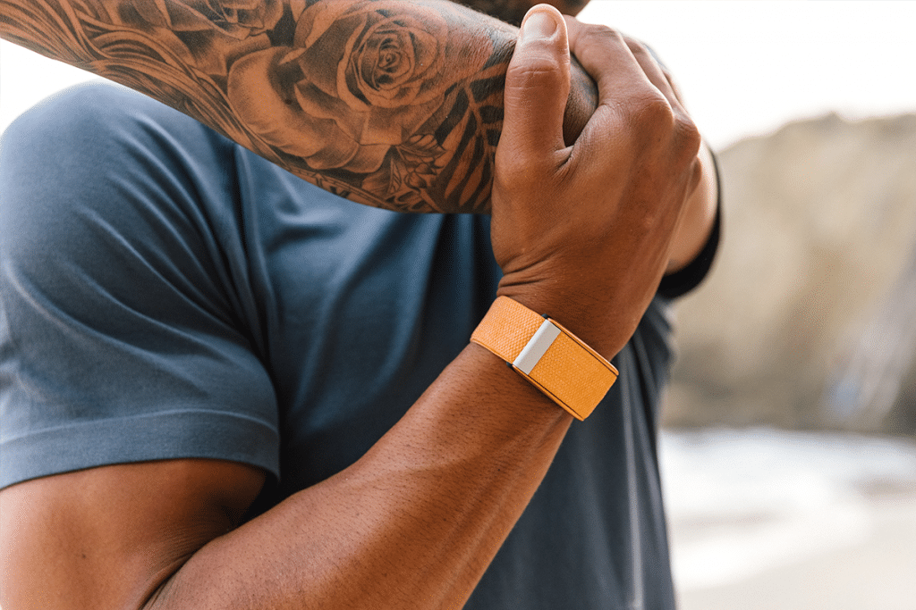 Man wearing Saffron Whoop on his wrist